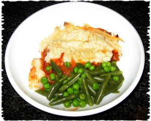 vegan cottage pie with fresh green beans and peas